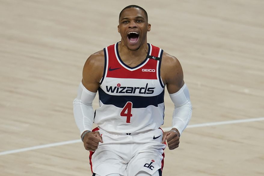 Washington Wizards guard Russell Westbrook (4) shouts before an NBA basketball game against the Oklahoma City Thunder, Friday, April 23, 2021, in Oklahoma City. (AP Photo/Sue Ogrocki)