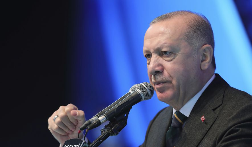 In this March 24, 2021, file photo, Turkey's President Recep Tayyip Erdogan gestures as he speaks during his ruling party's congress inside a packed sports hall in Ankara, Turkey. President Joe Biden on April 24, 2021 followed through on a campaign pledge to formally recognize that atrocities committed against the Armenian people by the Ottoman Empire more than a century ago in modern-day Turkey were genocide. This move is likely to strain U.S.-Turkey relations. (Turkish Presidency via AP, File)  **FILE**