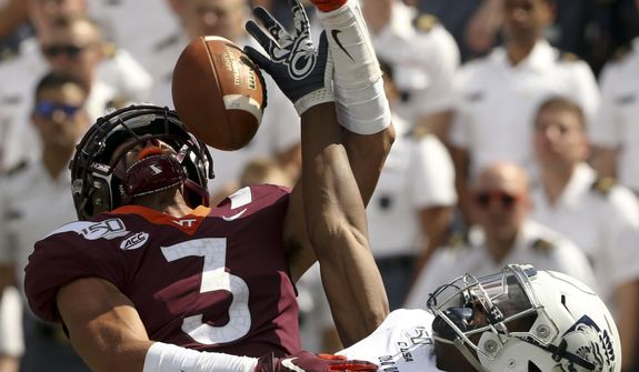 In this Sept. 7, 2019, file photo, Virginia Tech defender Caleb Farley (3) breaks up a pass in the end zone intended for Old Dominion receiver Hassan Patterson, right, during the second half of an NCAA college football game in Blacksburg Va. The Arizona Cardinals pick at No. 16 in the upcoming NFL draft and seem likely to target a defensive player, particularly a cornerback. There could be several opportunities to add one depending on how the picks shake out: Alabama's Patrick Surtain II, South Carolina's Jaycee Horn and Virginia Tech's Caleb.  (Matt Gentry/The Roanoke Times via AP, File) **FILE**
