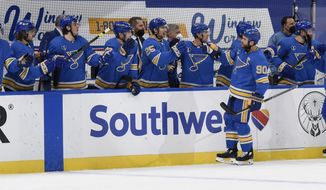 St. Louis Blues' Ryan O'Reilly (90) is congratulated by teammates after scoring his third goal of an NHL hockey game against the Colorado Avalanche during the third period Saturday, April 24, 2021, in St. Louis. (AP Photo/Joe Puetz)