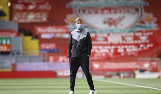 Liverpool's manager Jurgen Klopp stands ahead of he English Premier League soccer match between Liverpool and Newcastle United at Anfield stadium in Liverpool, England, Saturday, April 24, 2021. (David Klein, Pool via AP)