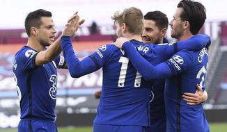 Chelsea's Timo Werner, centre, celebrates after scoring his side's opening goal during the English Premier League soccer match between West Ham United and Chelsea at London Stadium, London, England, Saturday, April 24, 2021. (Andy Rain/Pool via AP)