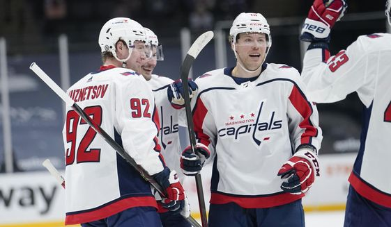 Washington Capitals' Daniel Sprong celebrates with teammates after scoring a goal during the third period of an NHL hockey game against the New York Islanders Saturday, April 24, 2021, in Uniondale, N.Y. The Capitals won 6-3. (AP Photo/Frank Franklin II)