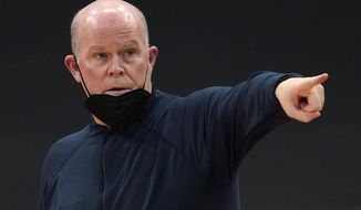 Orlando Magic head coach Steve Clifford calls a play during the second half of an NBA basketball game against the Toronto Raptors Friday, April 16, 2021, in Tampa, Fla. (AP Photo/Chris O'Meara)