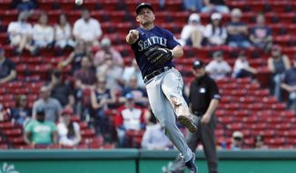 Seattle Mariners' Kyle Seager throws to first base on the ground out by Boston Red Sox's Christian Arroyo during the sixth inning of a baseball game, Saturday, April 24, 2021, in Boston. (AP Photo/Michael Dwyer)