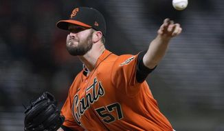 San Francisco Giants pitcher Alex Wood throws to a San Francisco Giants batter during the sixth inning of a baseball game Friday, April 23, 2021, in San Francisco. (AP Photo/Tony Avelar)