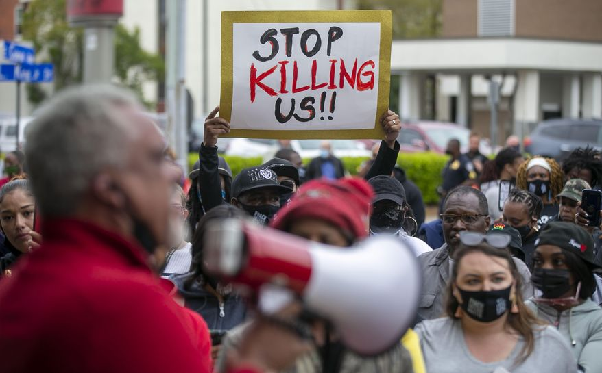 Kirk Rivers addresses demonstrators outside City Hall as they await members of the city council who held an emergency meeting on Friday, April 23, 2021, in Elizabeth City, N.C., in regards to the death of Andrew Brown Jr., who was shot and killed by a Pasquotank County Deputy Sheriff earlier in the week. (Robert Willett/The News & Observer via AP)