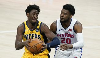 Indiana Pacers' Caris LeVert (22) goes to the basket against Detroit Pistons' Josh Jackson (20) during the second half of an NBA basketball game, Saturday, April 24, 2021, in Indianapolis. (AP Photo/Darron Cummings)