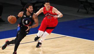 New York Knicks guard Derrick Rose (4) drives to the basket against Toronto Raptors forward Yuta Watanabe (18) during the first half of an NBA basketball game Saturday, April 24,2021, in New York. (AP Photo/Noah K. Murray)