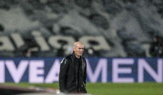 Real Madrid's head coach Zinedine Zidane looks on during the Spanish La Liga soccer match between Real Madrid and Betis at the Alfredo di Stefano stadium in Madrid, Spain, Saturday, April 24, 2021. (AP Photo/Bernat Armangue)