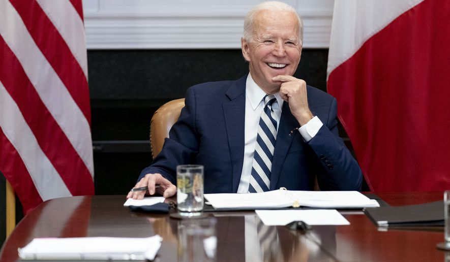 President Joe Biden speaks during a virtual meeting with Mexican President Andres Manuel Lopez Obrador, in the Roosevelt Room of the White House in Washington. (AP Photo/Andrew Harnik, File)