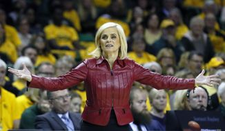 In this Thursday, March 5, 2020 file photo, Baylor head coach Kim Mulkey questions a call from the sidelines during an NCAA college basketball game against Texas in Waco, Texas. Hall of Fame coach Kim Mulkey has left Baylor to return home and take over the LSU women's basketball team. The school announced the move Sunday, April 25, 2021. (AP Photo/Ray Carlin, File) **FILE**