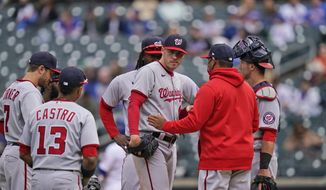 Washington Nationals starting pitcher Patrick Corbin, center, after he was pulled from the game during the fifth inning of a baseball game against the New York Mets at Citi Field, Sunday, April 25, 2021, in New York. (AP Photo/Seth Wenig)