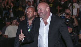 UFC President Dana White interacts with fans during a UFC 261 mixed martial arts event, Saturday, April 24, 2021, in Jacksonville, Fla. This is the first UFC event since the onset of the COVID-19 pandemic to feature a full crowd in attendance. (AP Photo/Gary McCullough)