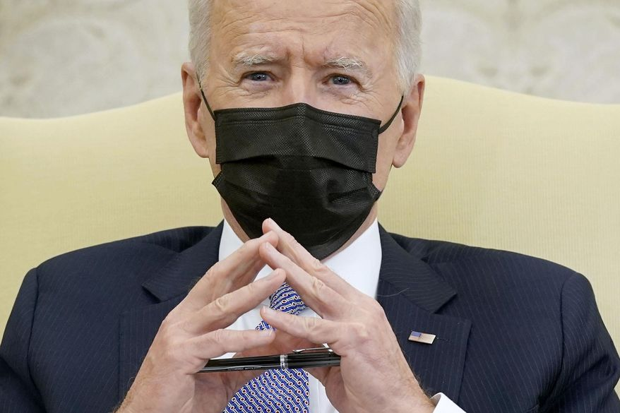 In this April 12, 2021, photo President Joe Biden speaks during a meeting with lawmakers to discuss the American Jobs Plan in the Oval Office of the White House in Washington. (AP Photo/Patrick Semansky) **FILE**