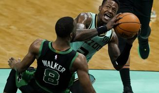 Charlotte Hornets guard Terry Rozier drives to the basket over Boston Celtics guard Kemba Walker during the first half of an NBA basketball game on Sunday, April 25, 2021, in Charlotte, N.C. (AP Photo/Chris Carlson)
