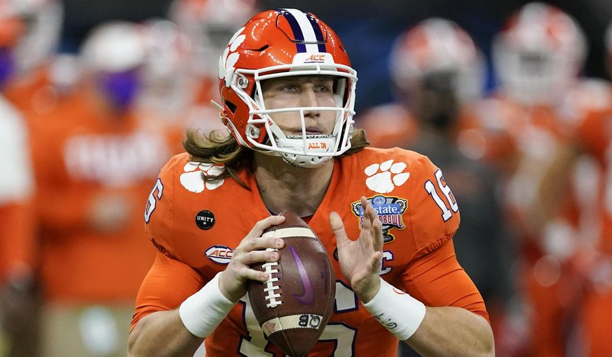 Clemson quarterback Trevor Lawrence passes against Ohio State during the first half of the Sugar Bowl NCAA college football game in New Orleans, Friday, Jan. 1, 2021. About the only certainty in the confounding 2021 NFL draft is Trevor Lawrence going to the Jaguars with the first overall pick Thursday night in Cleveland. This year's NFL draft is like none other because teams weren't able to meet face-to-face with the pool of prospects outside the lucky few who got to play in the Senior Bowl after a season that was marked by opt outs and cancellations. (AP Photo/John Bazemore, File) **FILE**