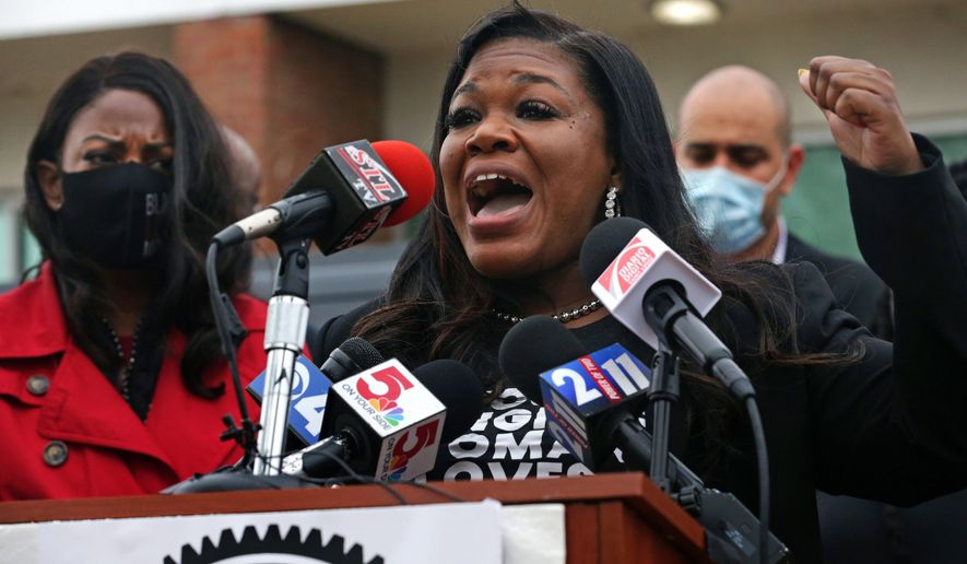 Congresswoman Cori Bush, D-St. Louis, addresses the press after touring both St. Louis jails on Saturday, April 24, 2021, outside the Medium Security Institution known as The City Workhouse. Standing to the left is St. Louis City Mayor Tishaura O. Jones. (Laurie Skrivan/St. Louis Post-Dispatch via AP)
