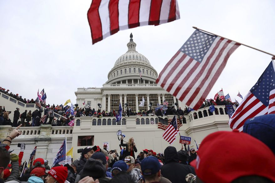 Supporters of President Donald Trump gather outside the U.S. Capitol, Wednesday, Jan. 6, 2021, in Washington. (AP Photo/Shafkat Anowar)