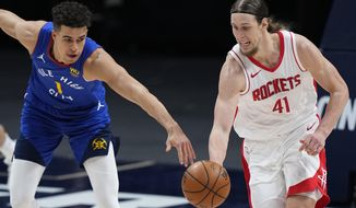 Denver Nuggets forward Michael Porter Jr. (1) and Houston Rockets forward Kelly Olynyk (41) chase the ball during the second half of an NBA basketball game Saturday, April 24, 2021, in Denver. (AP Photo/Jack Dempsey)
