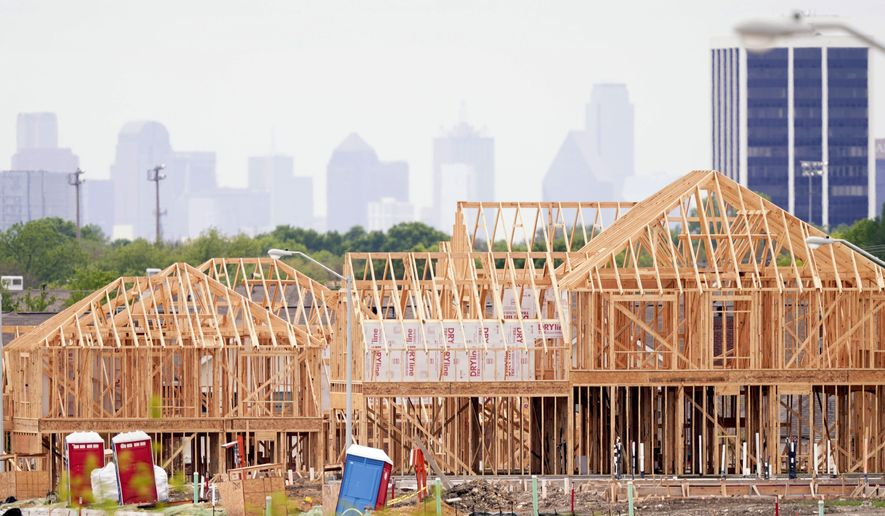 The frame of new home under construction sits in a neighborhood under development in north Dallas, Thursday, April 15, 2021.  (AP Photo/LM Otero)  **FILE**