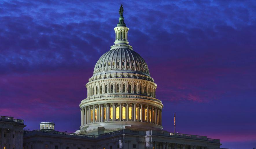 In this Nov. 6, 2020, photo, dawn arrives on Capitol Hill in Washington. (AP Photo/J. Scott Applewhite) **FILE**