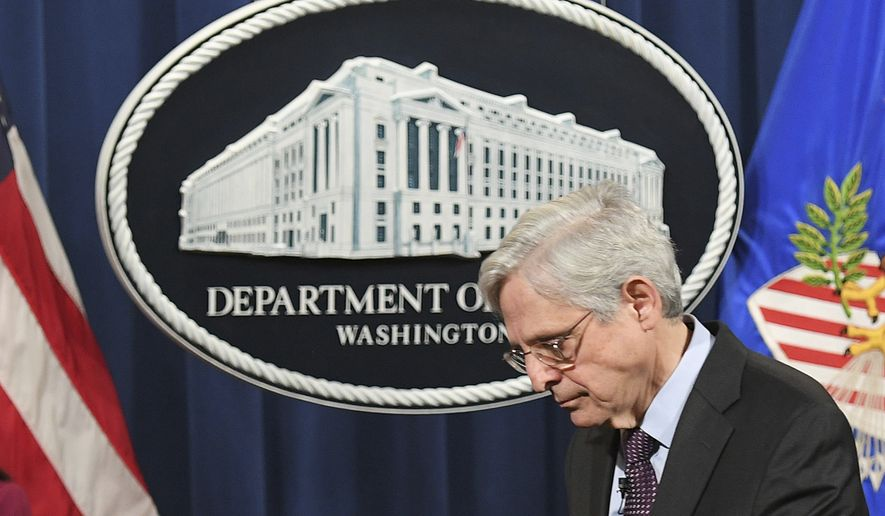 Attorney General Merrick Garland leaves after speaking at the Department of Justice in Washington, Monday, April 26, 2021. The Justice Department is opening a sweeping probe into policing in Louisville after the March 2020 death of Breonna Taylor, who was shot to death by police during a raid at her home. (Mandel Ngan/Pool via AP)