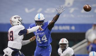 Kentucky linebacker Jamin Davis (44) rushes UT Martin quarterback John Bachus III (18) during the first half of an NCAA college football game in Lexington, Ky., in this Saturday, Nov. 23, 2019, file photo. Davis is a possible first round pick in the NFL Draft, April 29-May 1, 2021, in Cleveland. (AP Photo/Bryan Woolston, FIle). **FILE**