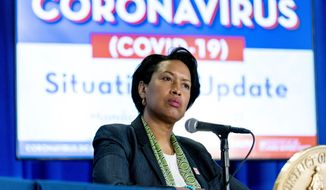 In this March 15, 2021, photo, Washington Mayor Muriel Bowser takes a question during a coronavirus update at a news conference in Washington. (AP Photo/Andrew Harnik) ** FILE **