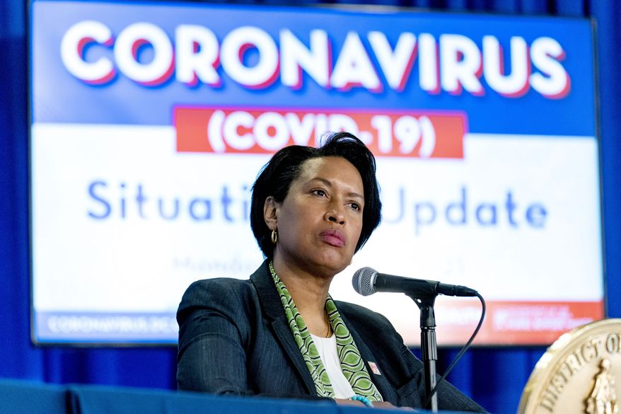 In this March 15, 2021, file photo, Washington Mayor Muriel Bowser takes a question during a coronavirus update at a news conference in Washington. (AP Photo/Andrew Harnik, File)