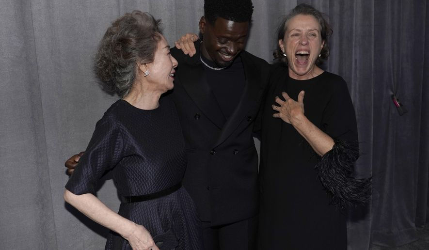 """Yuh-Jung Youn, from left, winner of the award for best actress in a supporting role for """"Minari,"""" Daniel Kaluuya, winner of the award for best actor in a supporting role for """"Judas and the Black Messiah,"""" and Frances McDormand, winner of the award for best actress in a leading role for """"Nomadland,"""" pose outside the press room at the Oscars on Sunday, April 25, 2021, at Union Station in Los Angeles. (AP Photo/Chris Pizzello, Pool)"""
