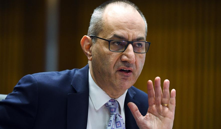 """Australia's Secretary of the Department of Home Affairs Mike Pezzullo speaks during a Senate inquiry at Parliament House in Canberra, on Oct. 19, 2020. Pezzullo's message to all department staff on Australia's veterans' day on Sunday, April 25, 2021, warned that free nations """"again hear the beating drums"""" of war, as military tensions rise in the Asia-Pacific region, according to The Australian newspaper. (Lukas Coch/AAP Image via AP)"""