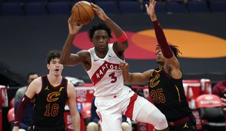 Toronto Raptors forward OG Anunoby (3) pass the ball between Cleveland Cavaliers forward Cedi Osman (16) and forward Isaac Okoro (35) during the second half of an NBA basketball game Monday, April 26, 2021, in Tampa, Fla. (AP Photo/Chris O'Meara)