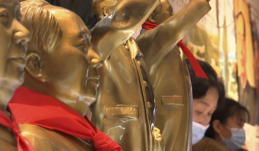 Souvenirs of the late Communist leader Mao Zedong are sold at a gift shop at the Jinggangshan Revolution Museum in Jinggangshan in southeastern China's Jiangxi province, on April 8, 2021. On the hundredth anniversary of the Chinese Communist Party, tourists in China are flocking to historic sites and making pilgrimages to party landmarks. (AP Photo/Emily Wang)