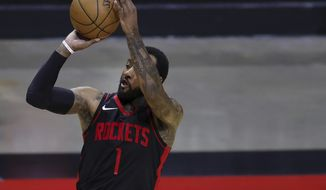 Houston Rockets' John Wall shoots a 3-point basket during the third quarter against the Los Angeles Clippers in an NBA basketball game Friday, April 23, 2021, in Houston. (Carmen Mandato/Pool Photo via AP) **FILE**