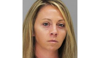 This October 2019 file booking photo provided by the Dallas County Sheriff's Department shows former Dallas Police Officer Amber Guyger. A Texas court is scheduled to hear arguments Tuesday, April 27, 2021, on overturning the conviction of Guyger, who was sentenced to prison for fatally shooting her neighbor in his home. (Dallas County Sheriff's Department via AP, File)