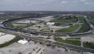 Police vehicles line the track at Indianapolis Motor Speedway Thursday, April 16, 2020, before the funeral of slain Indianapolis Metropolitan Police Department Officer Breann Leath. There are more than 300 acres inside the gates of the Indianapolis Motor Speedway, enough room to fit Vatican City, Yankee Stadium, The White House, Liberty Island, the Taj Majal, Roman Colosseum, Churchill Downs and the Rose Bowl. All at the same time. So if there's a facility that can safely host 135,000 fans during a pandemic, it would be Indianapolis. The speedway has been approved to host 40% its capacity for the Indy 500 next month, which will make it the largest sporting event since the start of the pandemic. (The Indianapolis Star via AP)