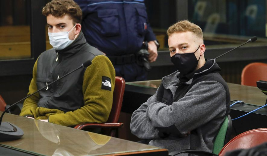 Gabriel Natale-Hjorth, from the United States, left, and his co-defendant Finnegan Lee Elder wear face masks to curb the spread of COVID-19 as they sit during a break of a hearing in the trial where they are facing murder charges after Italian Carabinieri paramilitary police officer Mario Cerciello Rega was fatally stabbed on a Rome street in July 2019, in Rome, Monday, April 26, 2021.  (Remo Casilli/Pool Photo via AP)