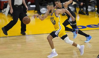 Golden State Warriors guard Stephen Curry (30) steals the ball from Sacramento Kings guard Tyrese Haliburton (0) during the first half of an NBA basketball game on Sunday, April 25, 2021, in San Francisco. (AP Photo/Tony Avelar)