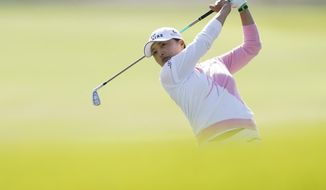 Jin Young Ko hits from the 15th fairway during the final round of the LPGA's Hugel-Air Premia LA Open golf tournament at Wilshire Country Club Saturday, April 24, 2021, in Los Angeles. (AP Photo/Ashley Landis)