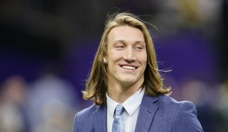 Clemson quarterback Trevor Lawrence arrives before the NCAA College Football Playoff national championship game against LSU in New Orleans, in this Monday, Jan. 13, 2020, file photo. Lawrence is a likely top pick in the NFL Draft, April 29-May 1, 2021, in Cleveland. (AP Photo/David J. Phillip, File) **FILE**