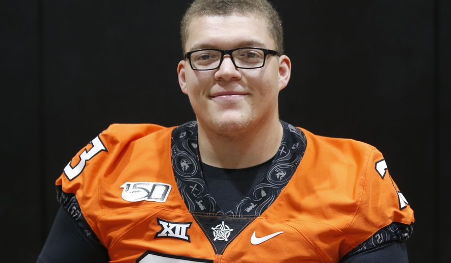 FILE - Oklahoma State offensive lineman Teven Jenkins is pictured during an NCAA college football media day in Stillwater Okla., in this Saturday, Aug. 3, 2019, file photo. Jenkins is a possible first round pick in the NFL Draft, April 29-May 1, 2021, in Cleveland.(AP Photo/Sue Ogrocki, File)