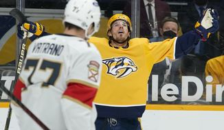 Nashville Predators center Nick Cousins, right, celebrates after scoring a goal against the Florida Panthers in the second period of an NHL hockey game Monday, April 26, 2021, in Nashville, Tenn. (AP Photo/Mark Humphrey)