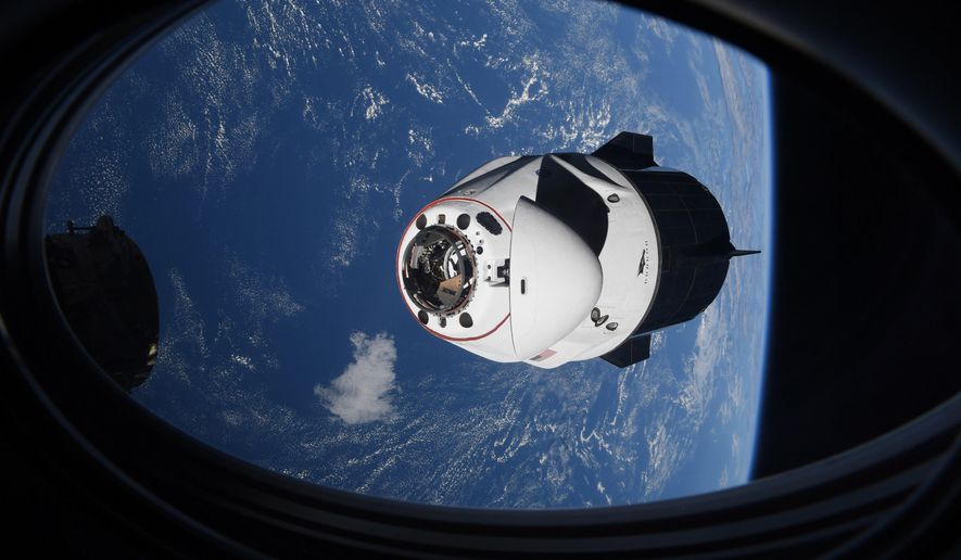 In this Saturday, April 24, 2021, file photo made available by NASA, the SpaceX Crew Dragon capsule approaches the International Space Station for docking. SpaceX's four astronauts had barely settled into orbit on Friday, April 23, when they were ordered back into their spacesuits because of a potential collision with orbiting junk. It turns out there was no threat, the U.S. Space Command acknowledged Monday, April 26. The error is under review. (NASA via AP)