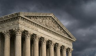FILE - In this June 20, 2019, file photo, the Supreme Court is seen in Washington as a storm rolls in. The Supreme Court has agreed to hear an appeal to expand gun rights in the United States in a New York case over the right to carry a firearm in public for self-defense. (AP Photo/J. Scott Applewhite, File)