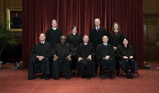 In this April 23, 2021, file photo members of the Supreme Court pose for a group photo at the Supreme Court in Washington. Seated from left are Associate Justice Samuel Alito, Associate Justice Clarence Thomas, Chief Justice John Roberts, Associate Justice Stephen Breyer and Associate Justice Sonia Sotomayor, Standing from left are Associate Justice Brett Kavanaugh, Associate Justice Elena Kagan, Associate Justice Neil Gorsuch and Associate Justice Amy Coney Barrett. Before the Supreme Court this is week is an argument over whether public schools can discipline students over something they say off-campus. (Erin Schaff/The New York Times via AP, Pool, File)