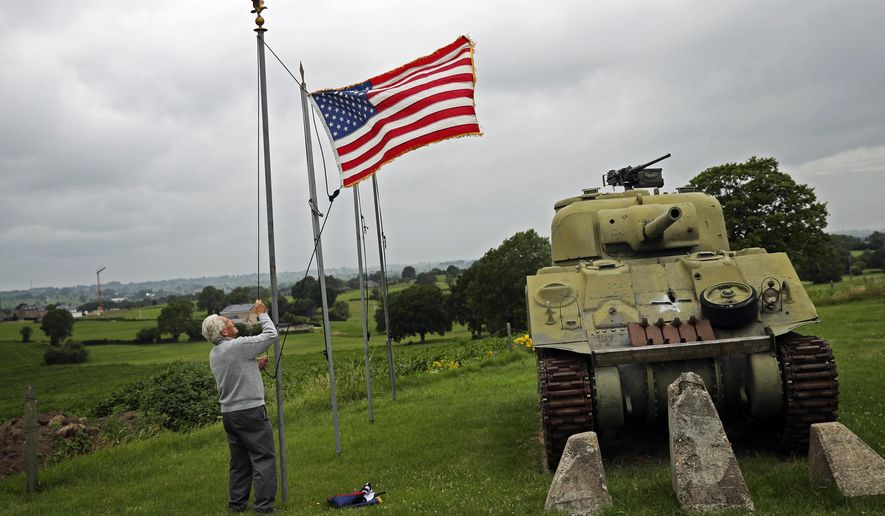 In this Wednesday, July 1, 2020, file photo, Marcel Schmetz raises the U.S. flag next to a WWII American Sherman tank at his Remember Museum 39-45 in Thimister-Clermont, Belgium. Tourists from the United States who are fully vaccinated against COVID-19 could be able to travel across the European Union this summer, officials from the 27-nation bloc said on Monday, April 26, 2021. (AP Photo/Francisco Seco, File)