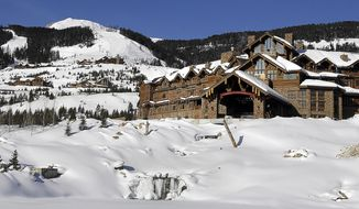 FILE - This undated file photo shows the Yellowstone Club near Big Sky, Mont. It may get tougher for Yellowstone Club members like Bill Gates and Justin Timberlake to get a drink the next time they go skiing at the exclusive club for the ultra-rich in Montana. Dozens of Jamaican citizens recruited to work at a Montana ski resort for the ultra-rich have reached a $1 million settlement over allegations they were discriminated against and paid less than other employees to do the same work. (Erik Petersen/Bozeman Daily Chronicle via AP, File)