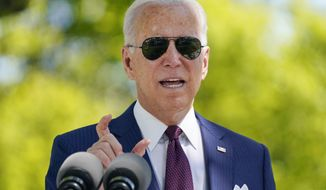 President Joe Biden responds to a question from reporters about COVID-19, on the North Lawn of the White House, Tuesday, April 27, 2021, in Washington. (AP Photo/Evan Vucci)