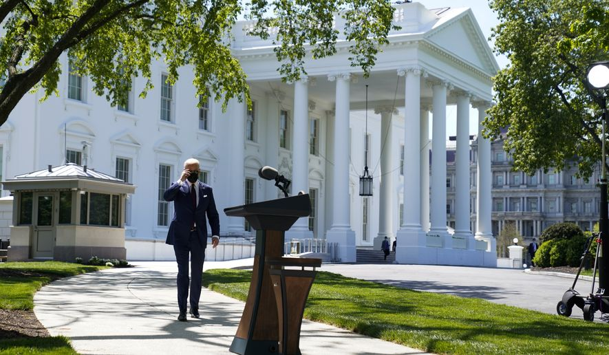 President Joe Biden arrives to speak about the CDC's new masking guidelines on the North Lawn of the White House, Tuesday, April 27, 2021, in Washington. (AP Photo/Evan Vucci)  **FILE**